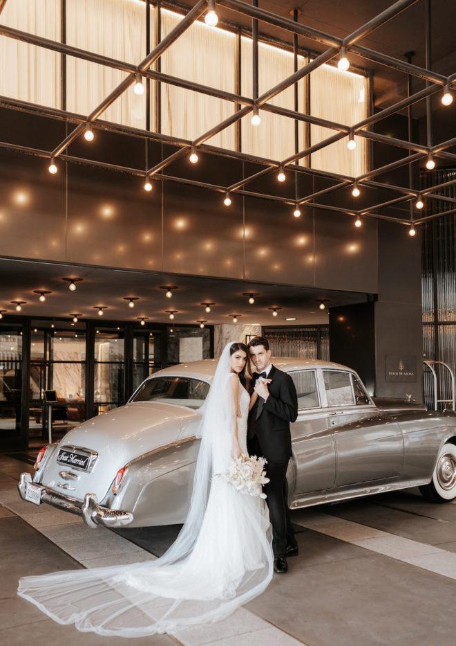 Four Seasons Hotel Houston, exterior, hotel car, vintage car, train, long veil, beadwork, bouquet, retro style, tuxedo, modern, refined, outdoor, getaway