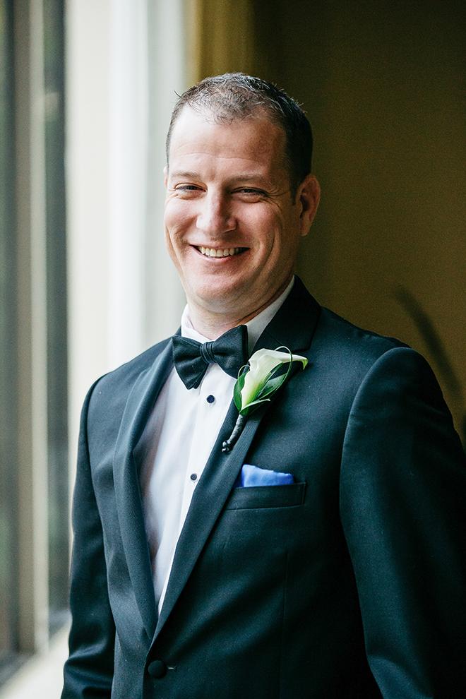 groom portrait, groom, groomswear, groom's suit, black, bow tie