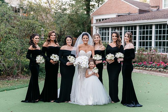 black bridesmaids dresses, off the shoulder, strapless bridal gown, long veil, orchid bouquet, white, elegant, classic, flower girl
