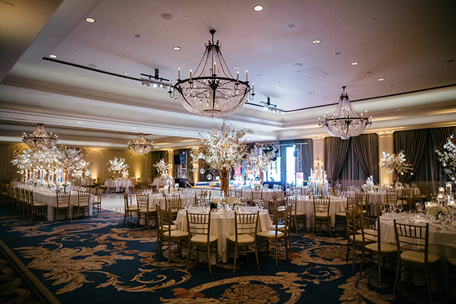 enchanted wedding, white orchids, candles, cherry blossom trees, floating candles, orbs, tall tapered candles, reception decor, white linens, the houstonian