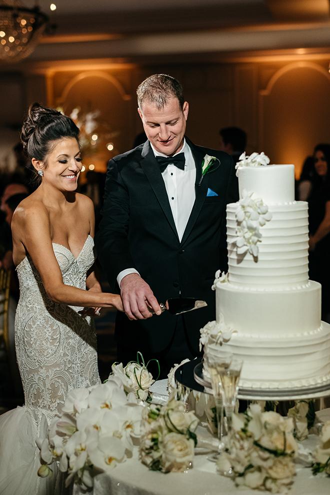 cutting the cake, susie's cakes, white, classic, elegant, orchids