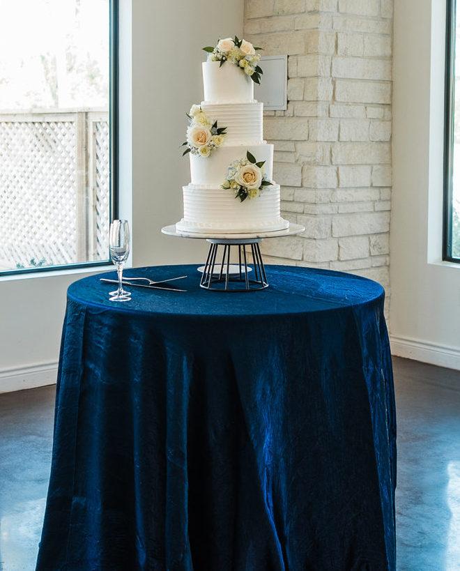 cake, cream, roses, 4-tiered, champagne, flute, metallic blue, blush, modern, florals, white, simple, modern, wedding cake