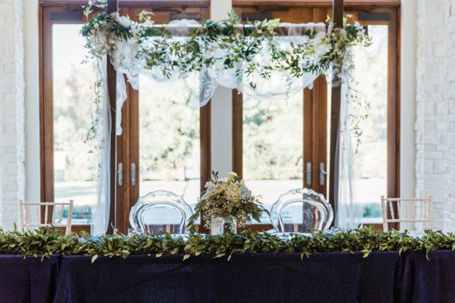 ghost chair, chiavari, greenery, bouquet, calli lillies, hydrangea, peonies, sage, blue, cream, white, wedding table, farmhouse table, modern, acrylic, green, ballroom, reception