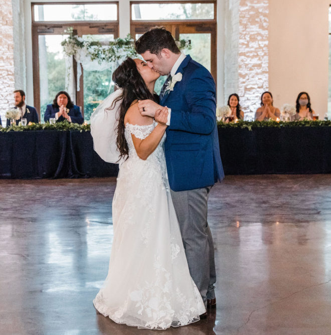 kiss, dance, ballroom, open concept, metallic blue, blue, greenery, wedding party, bridesmaids, groom, white, lace, veil, hydrangea, boutonniere, suit, ring, bridal style
