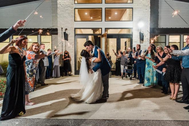 sparklers, send off, modern, venue, 15 Acres, guest, bride, groom, veil, gown, suit, navy, blue, evening, sparkler arc