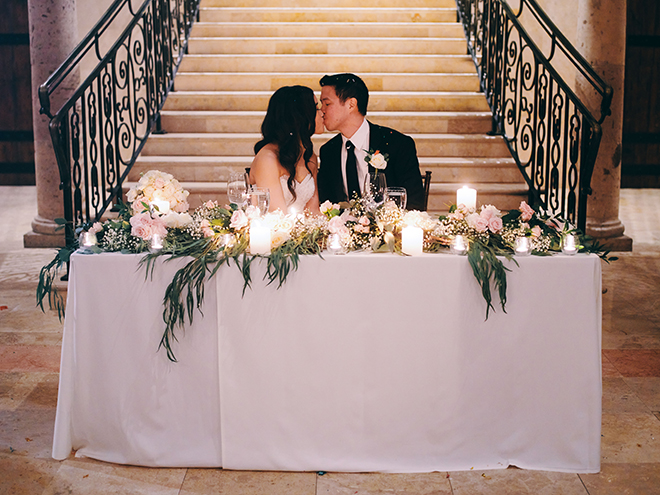dreamy, european inspired wedding, sweetheart table, his her table, greenery, runner, garland, bride, groom, bell tower on 34th