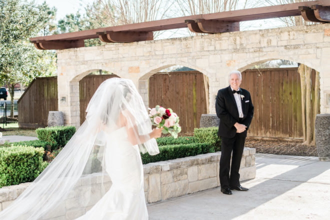 Father sees bride for the first time on the wedding day.