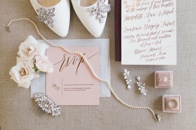Blush wedding invitations with white crystal embellished wedding heels.