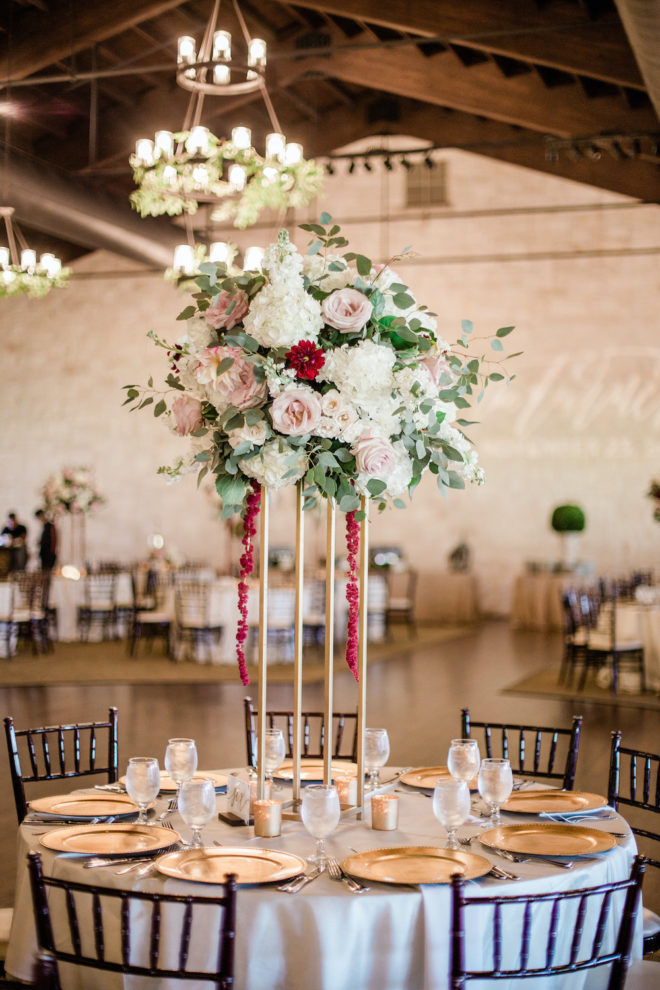 Blush and wine floral table centerpiece for reception.