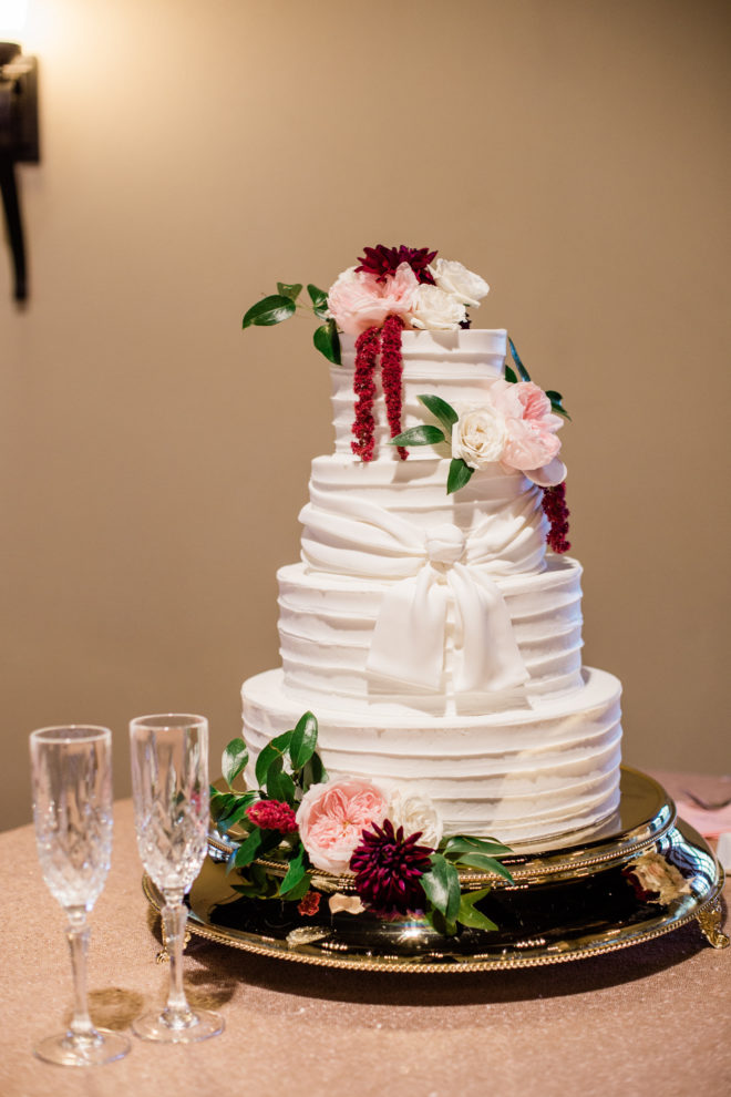 Blush and wine floral four tiered wedding cake