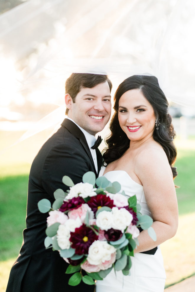 Fall bride and groom portrait with blush and wine bouquet.