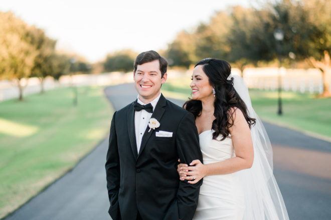 Fall groom and bride smiling outside.