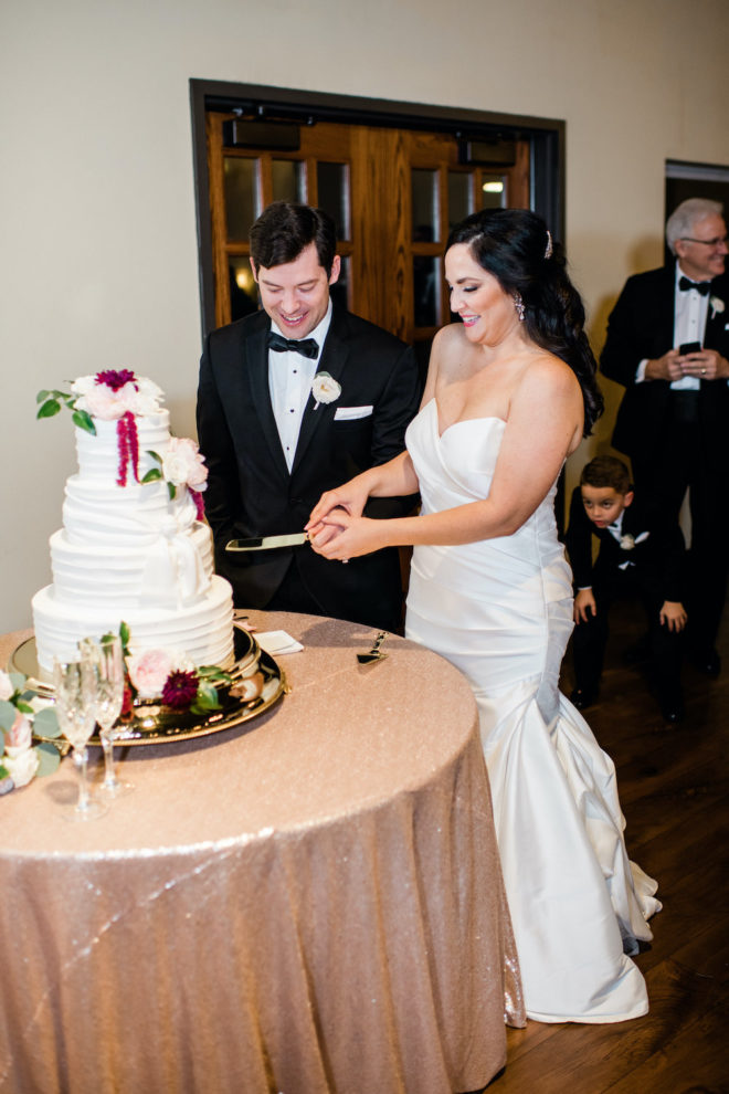 Bride and groom cute blush and wine floral wedding cake.