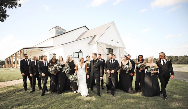 Couple , bridesmaids, and groomsmen at Deep In The Heart Farms.