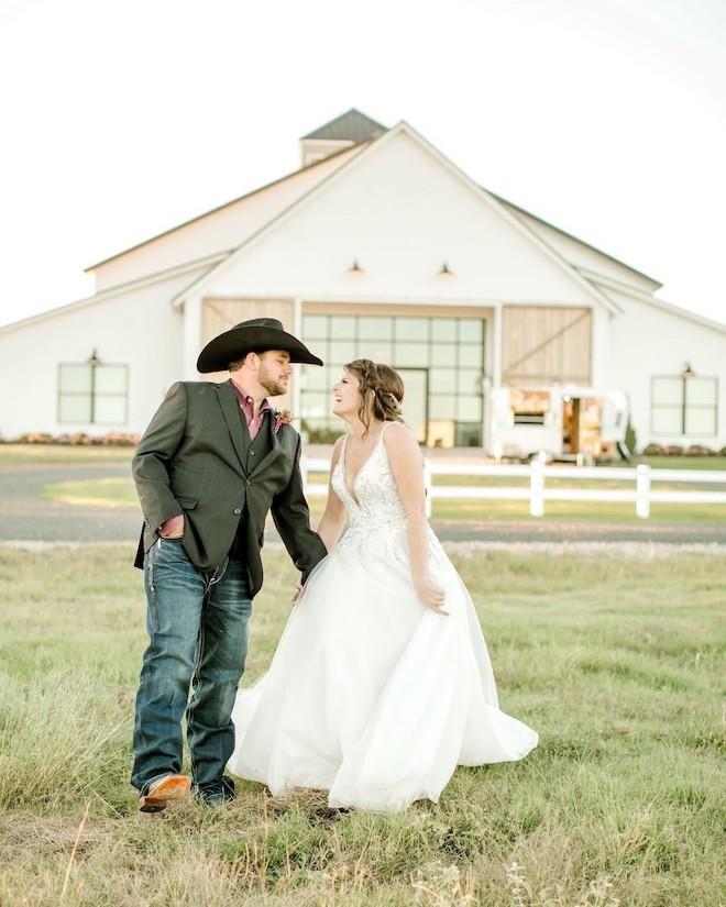 Rustic barn wedding with cowboy boots.
