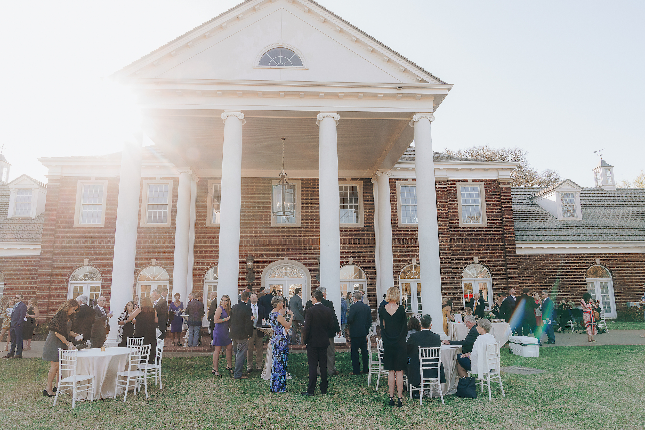 Exterior shot of the Mansion at ColoVista with guests waiting for the reception.
