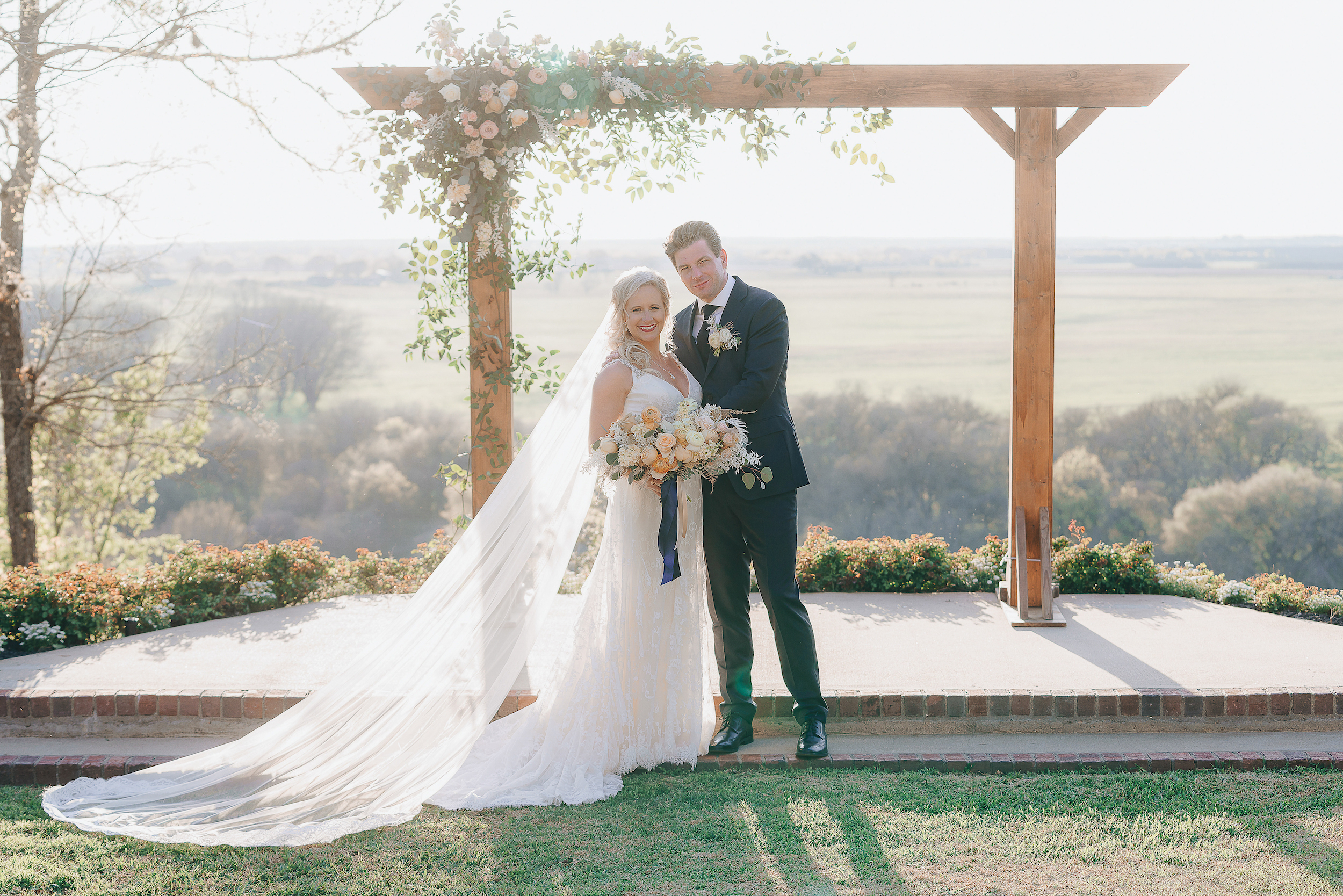Couple posing at the altar in the Texas hill country