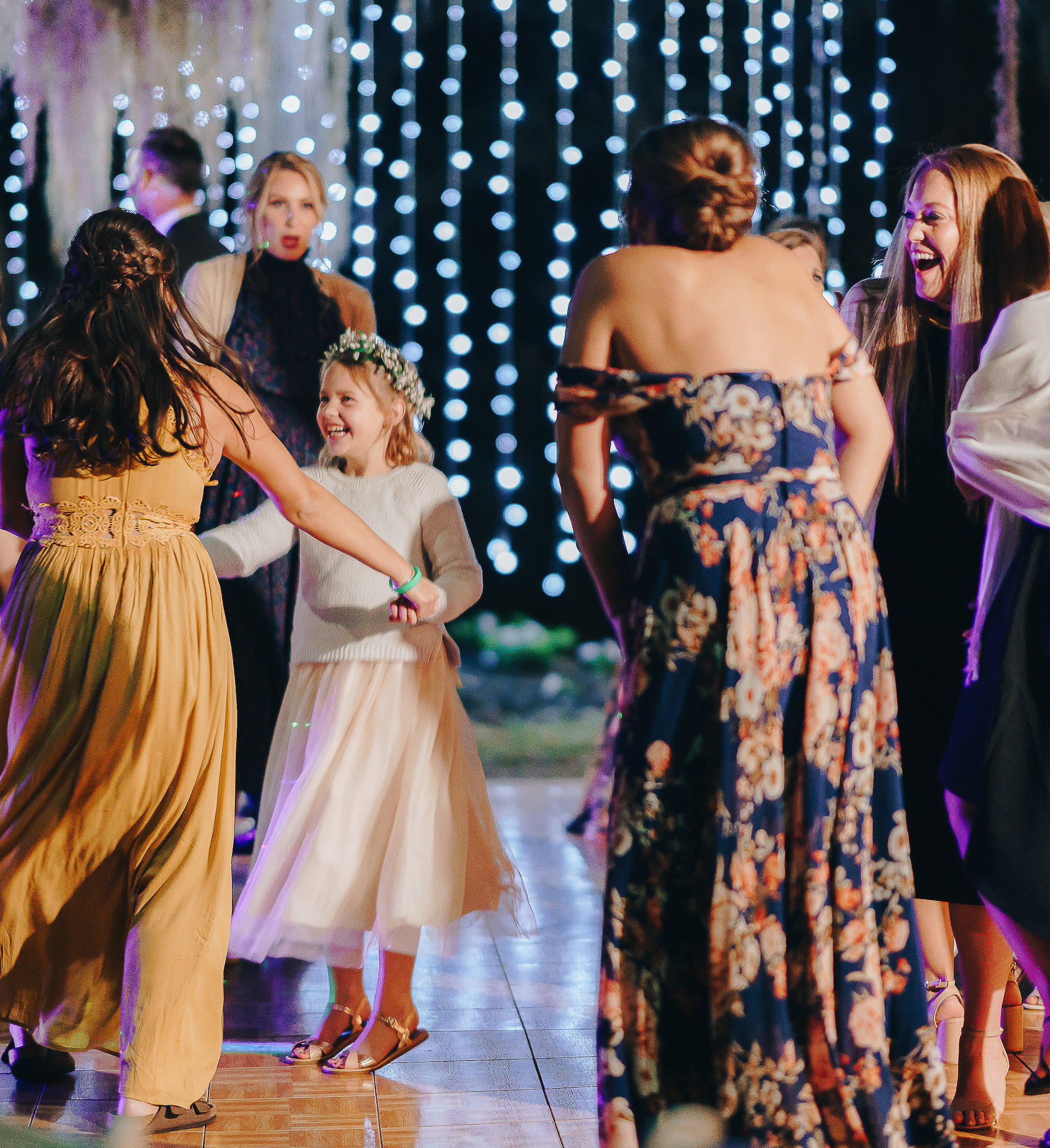 guests and little girl dancing at hill country wedding reception