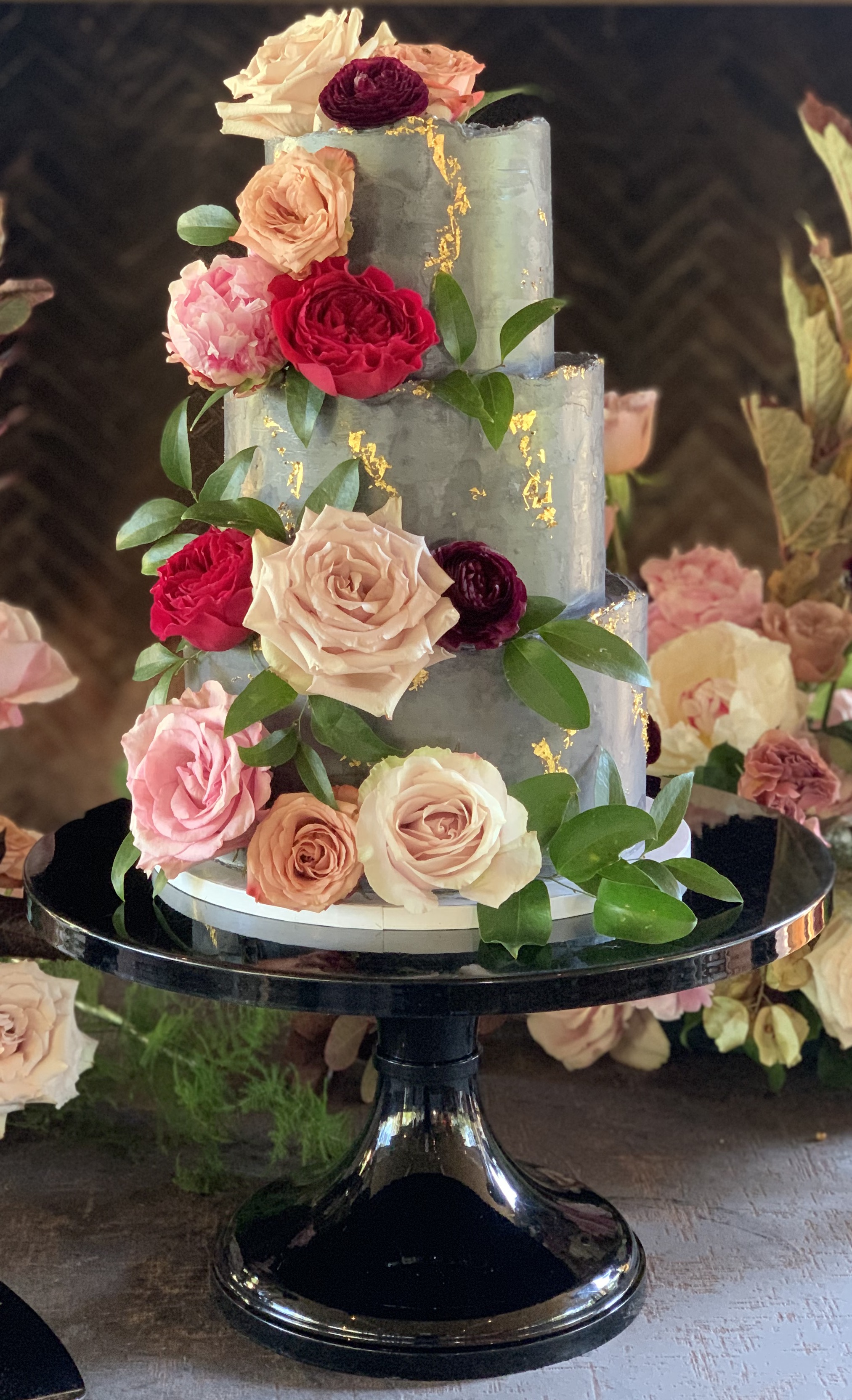 Sage and gold cake with blush and pink roses.