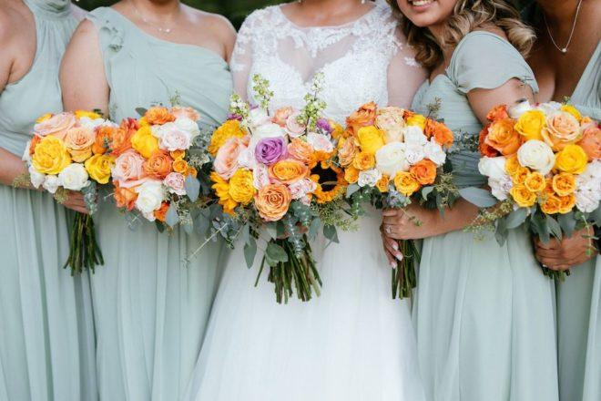 Multi-colored orange, white, and yellow bridesmaids bouquet.