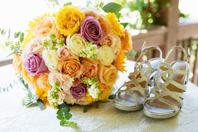 Multi-colored orange, white, and yellow flower bouquet.