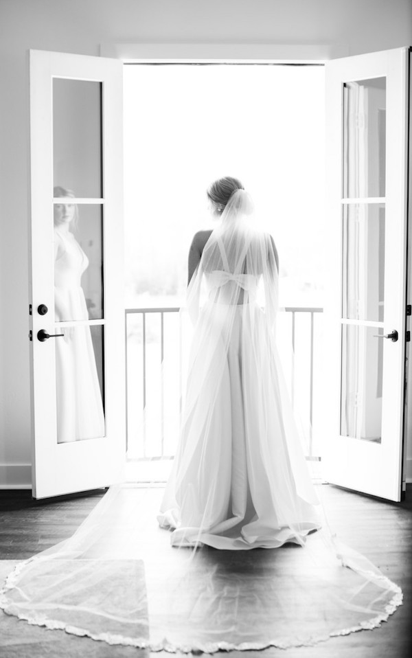 Bride from the back with veil in black and white.