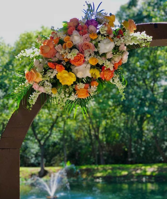 Multi-colored orange, white, and yellow flower arrangements.
