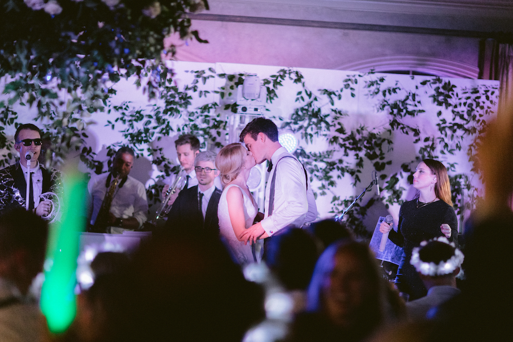Bride and groom share kiss during the night time show by Danny Ray and the acoustic production.