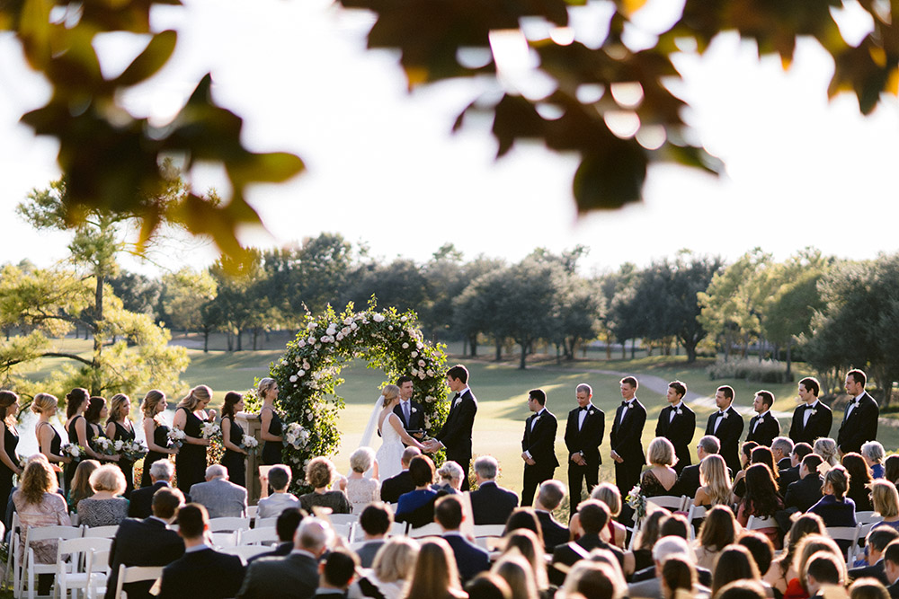 Outside ethereal and elegant blush wedding ceremony at sunset at the Royal Oaks Country Club.