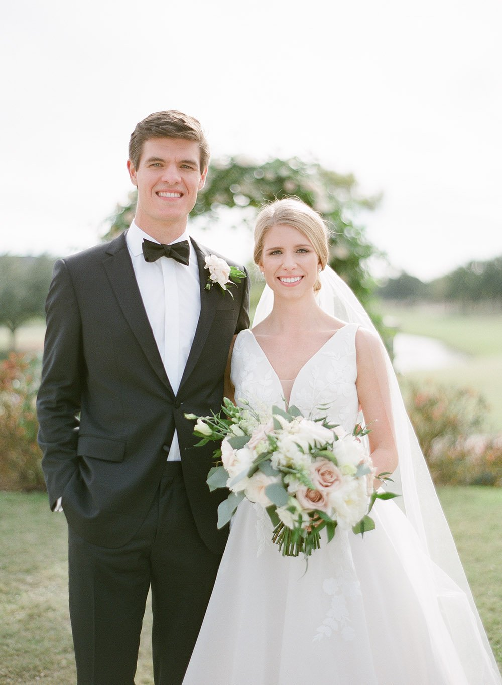 Bride and groom in an ethereal, classic, and elegant blush wedding.