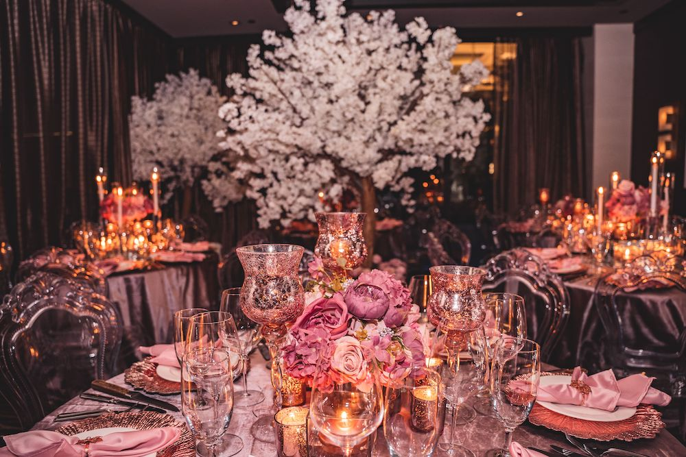 Pink and mauve wedding decor with dark silks and white cherry blossom trees, beautifully created by Mod Effect Events.