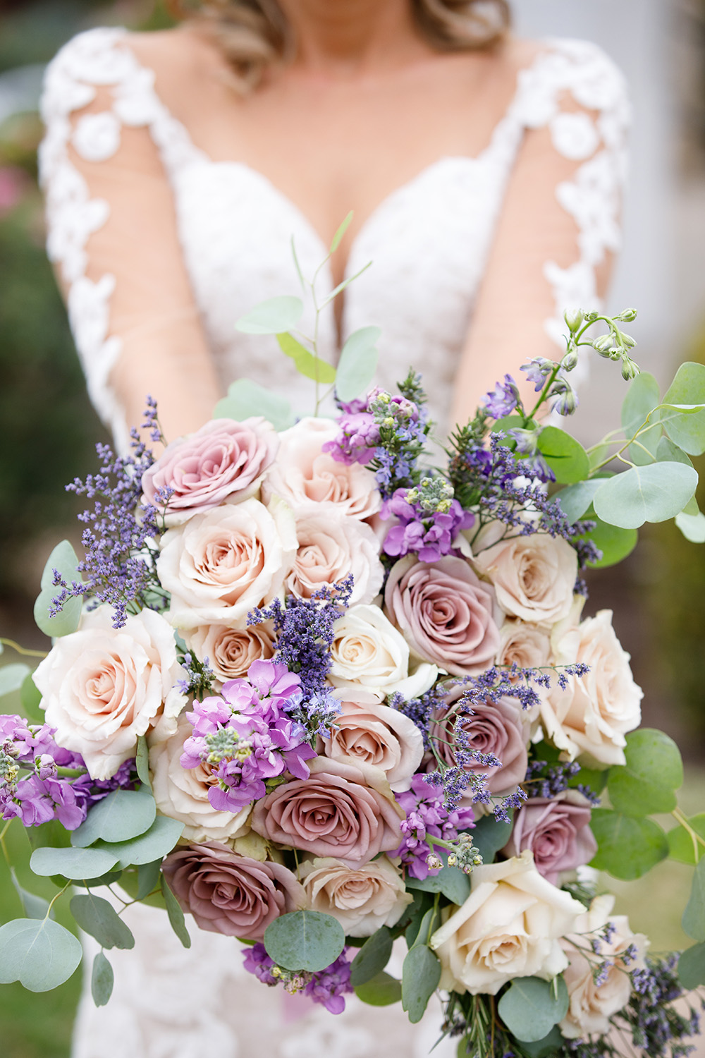 Romantic flower bouquet including rose gold roses, lavender, eucalyptus and violet hydrangeas by Malleret Designs.