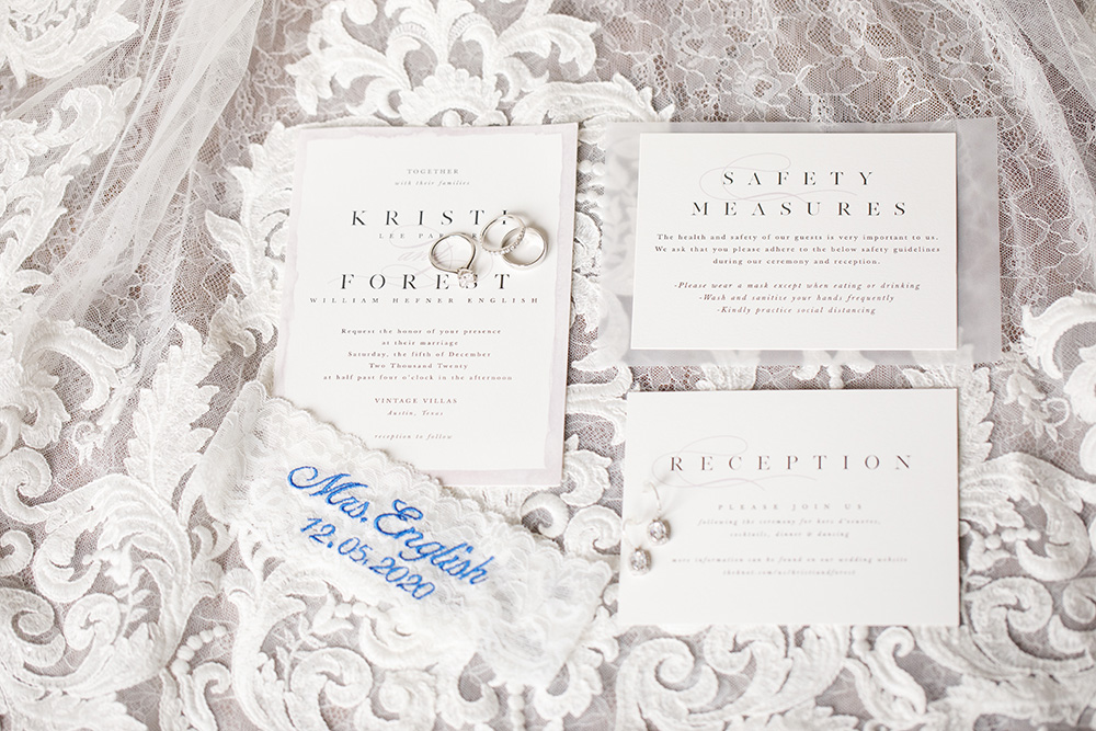 Silver, white, and ivory wedding invitations.