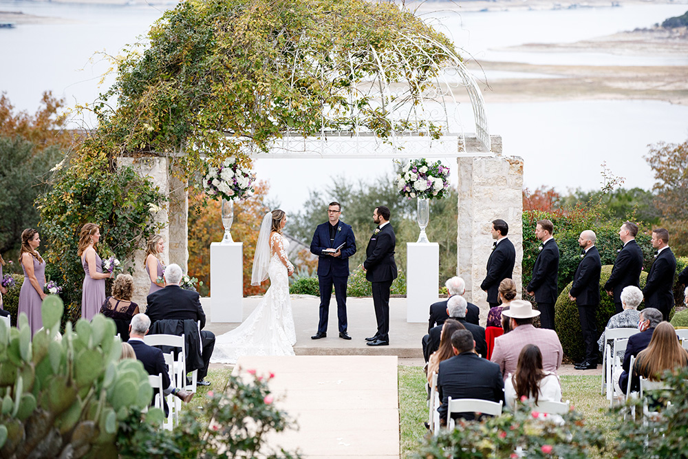 Lake front wedding ceremony at Lake Travis by Malleret Designs.