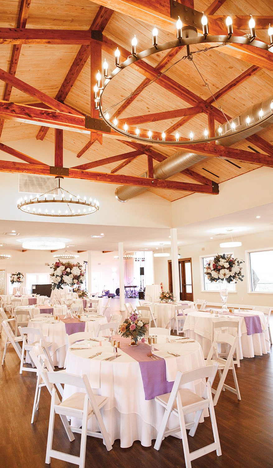 Charming lush white and lilac floral table reception decor designed by Malleret Designs.