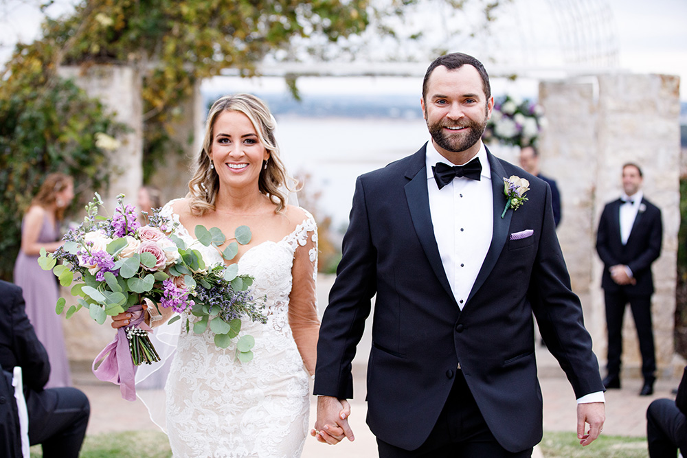 Lake front wedding ceremony at Lake Travis designed by Malleret Designs.