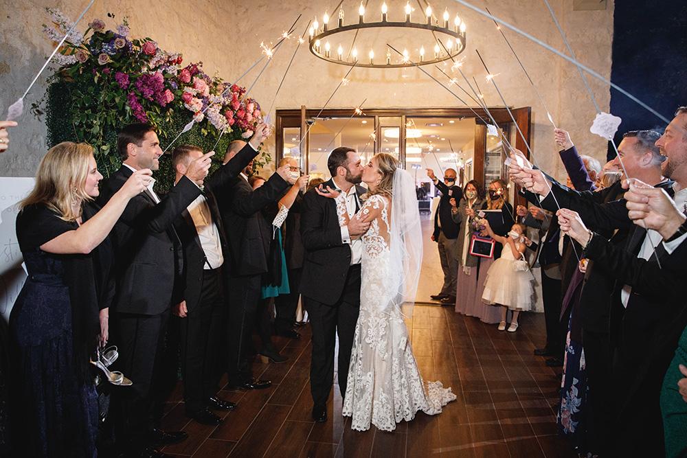 Sparkler wedding send-off at wedding venue.
