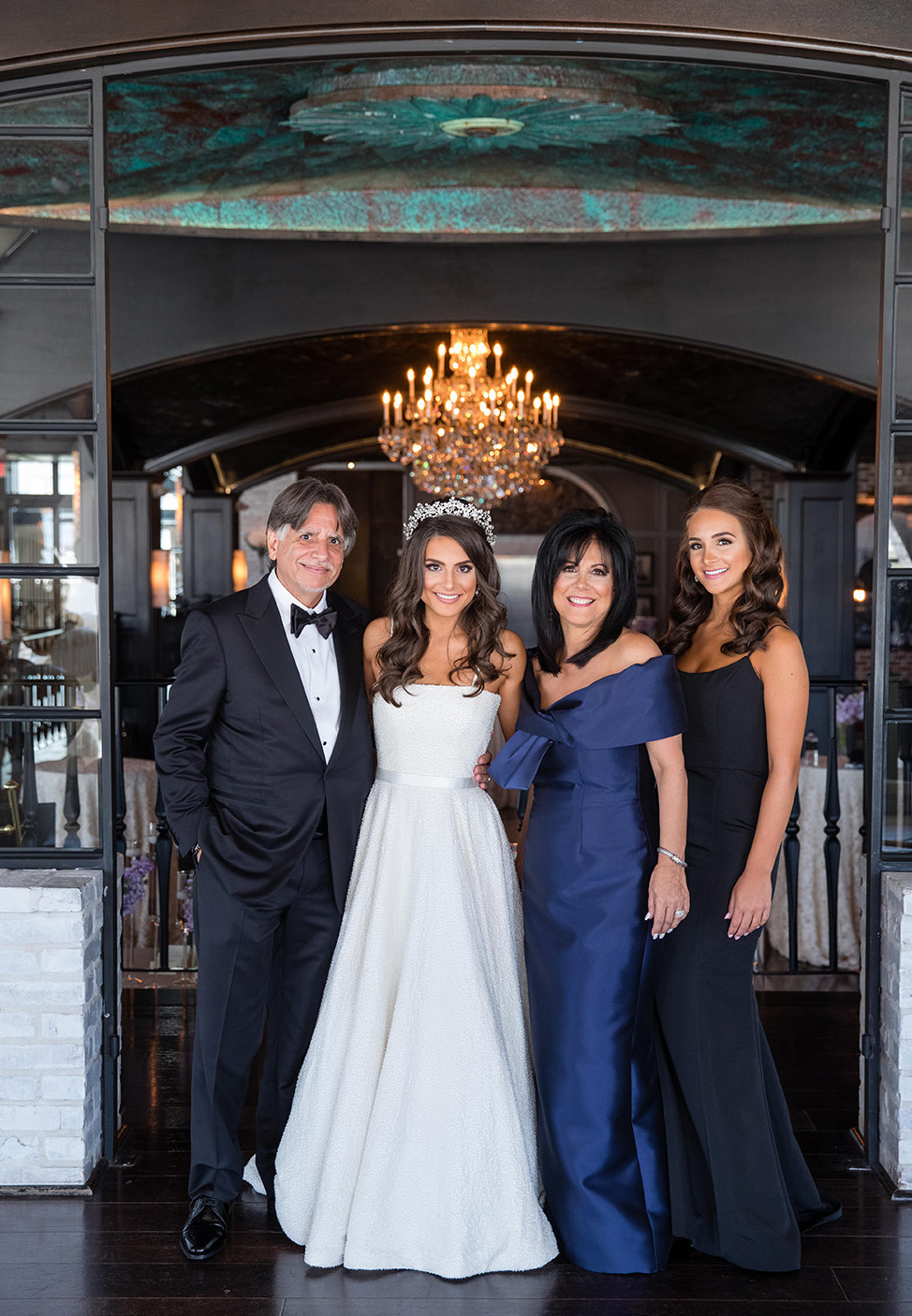Bride and family takes photo in The Astorian before reception.