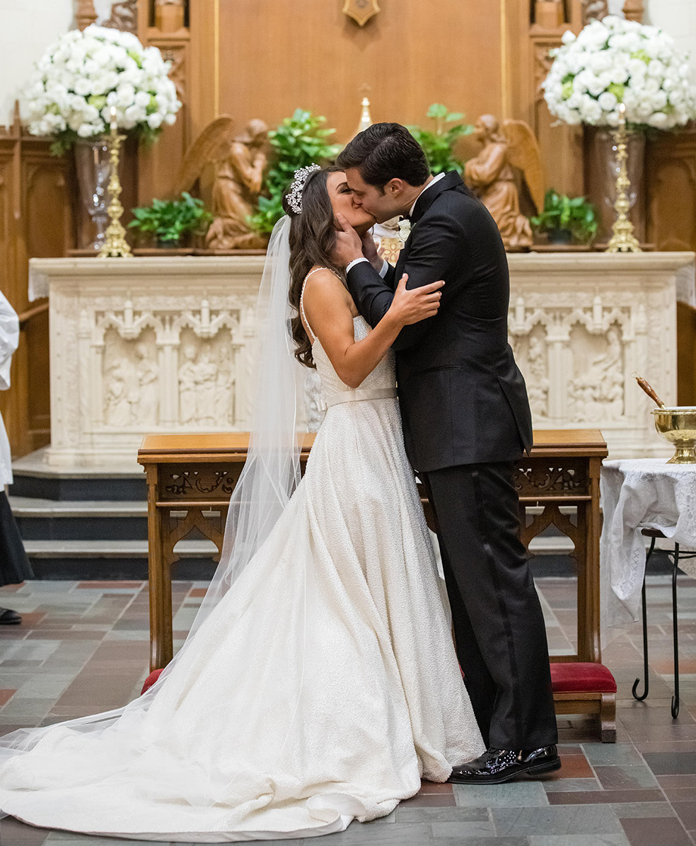 Bride and groom share a kiss at their ceremony.