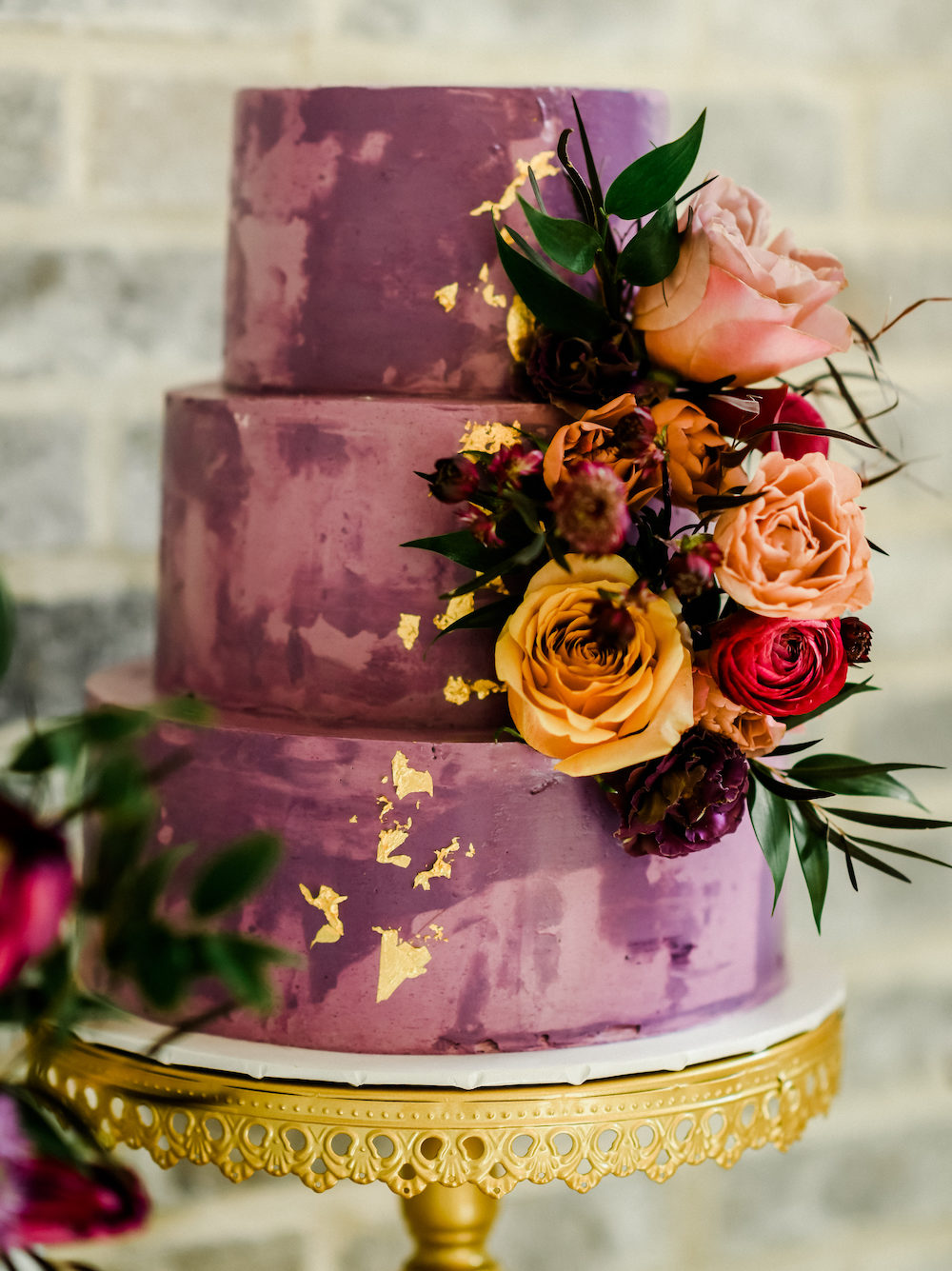 Becca's Cakes three tiered purple and gold accented cake.