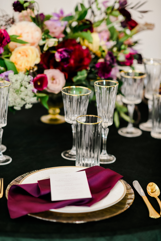 Mauve and green velvet wedding table decor.