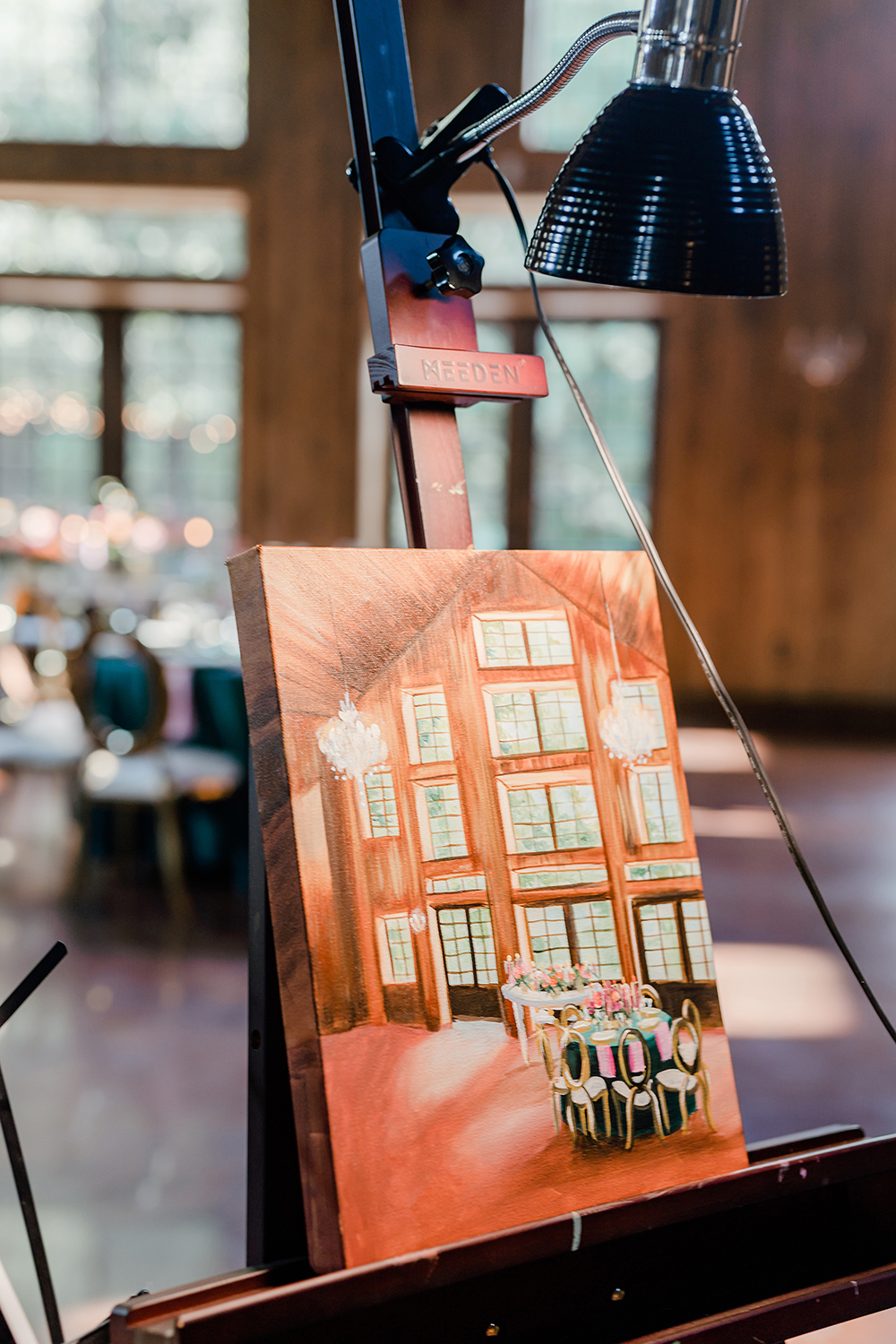 An oil painting (by live painter, Rendered Moments) of an intimate wedding reception inside of The Carriage House wedding venue in Conroe, Texas.