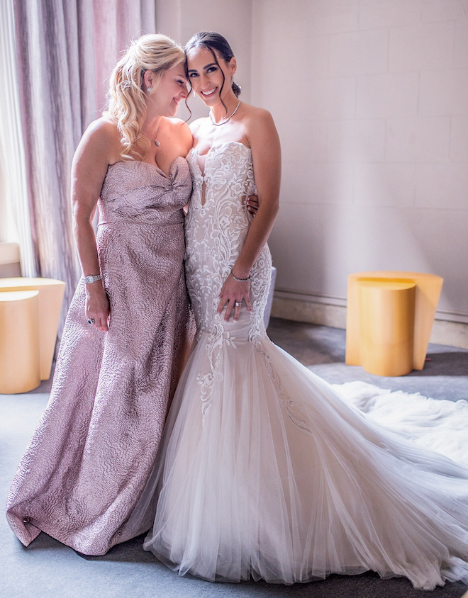 Mother of bride and bride share an intimate moment at a bridal lounge in the Corinthian Houston.