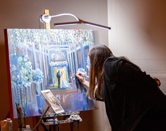Artist paints a moment shared between the bride and groom on a canvas inside the Corinthian Houston.