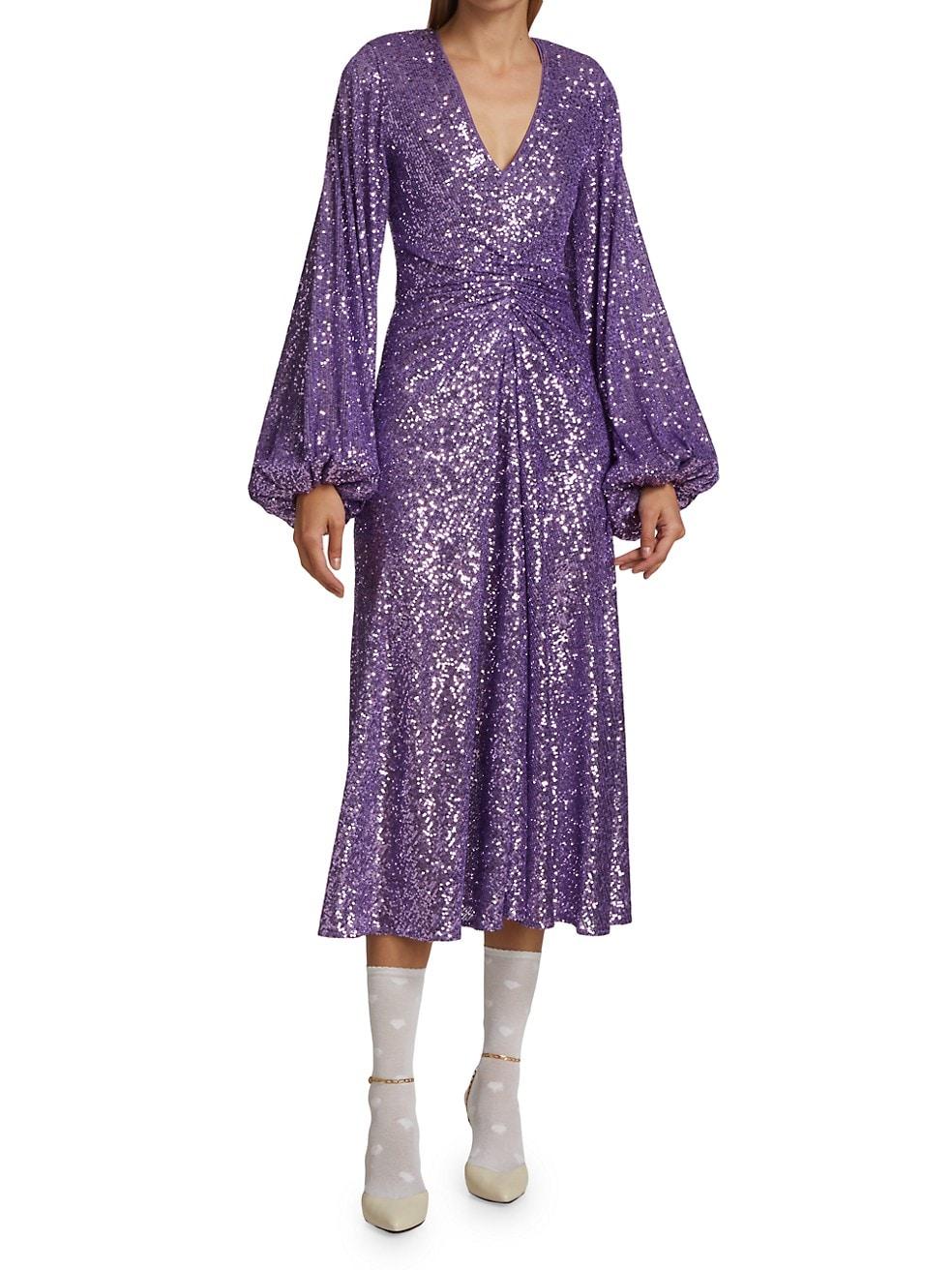 Purple sequin puff sleeve midi dress for winter wedding guest.