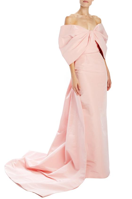 Light pink off the shoulder gown with a train for spring wedding guest