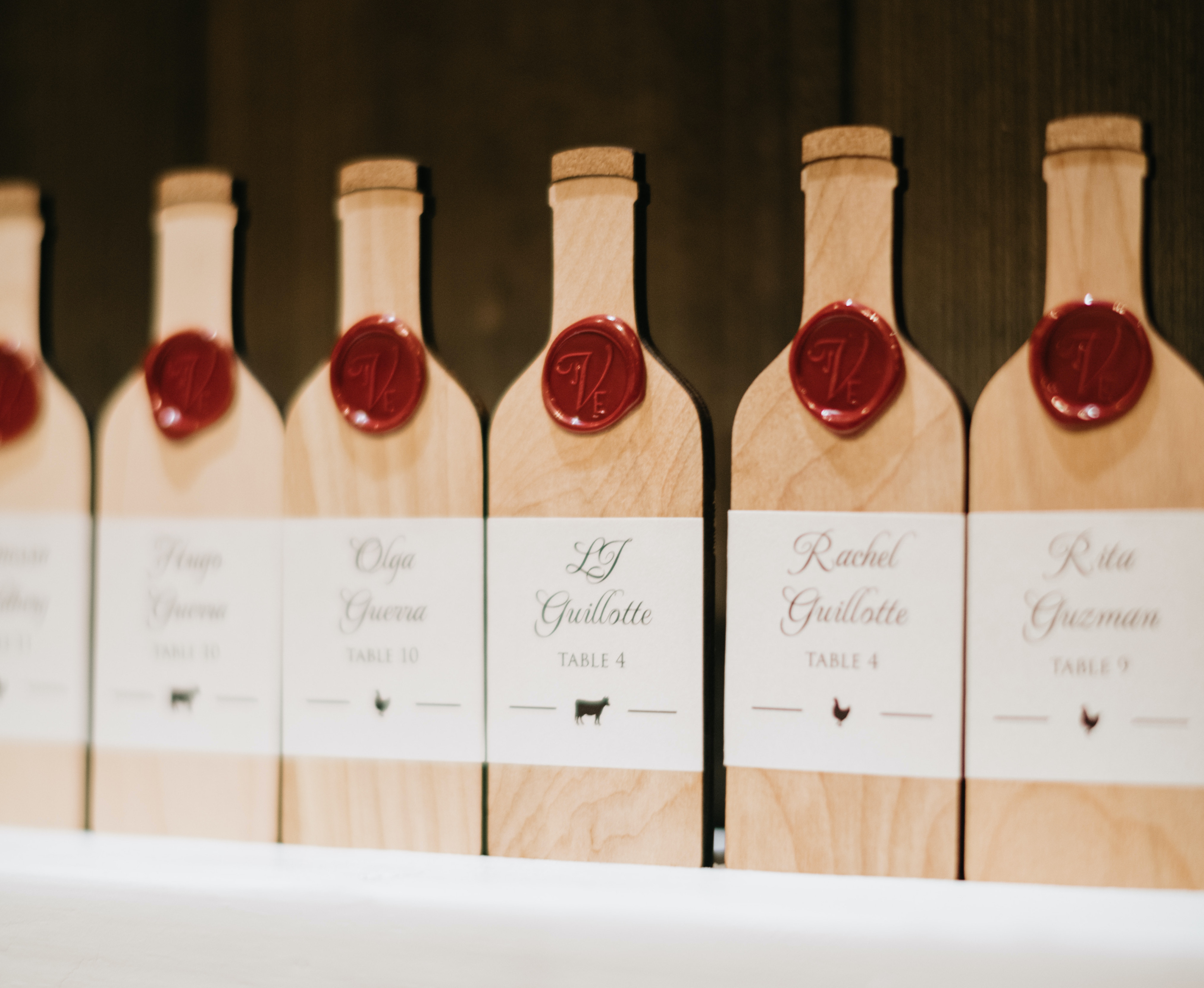 Custom guest list made out of wooden wine bottle cut-outs.