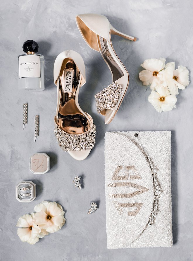 The bride's shoes with her accessories and beaded clutch at a downtown Houston wedding.