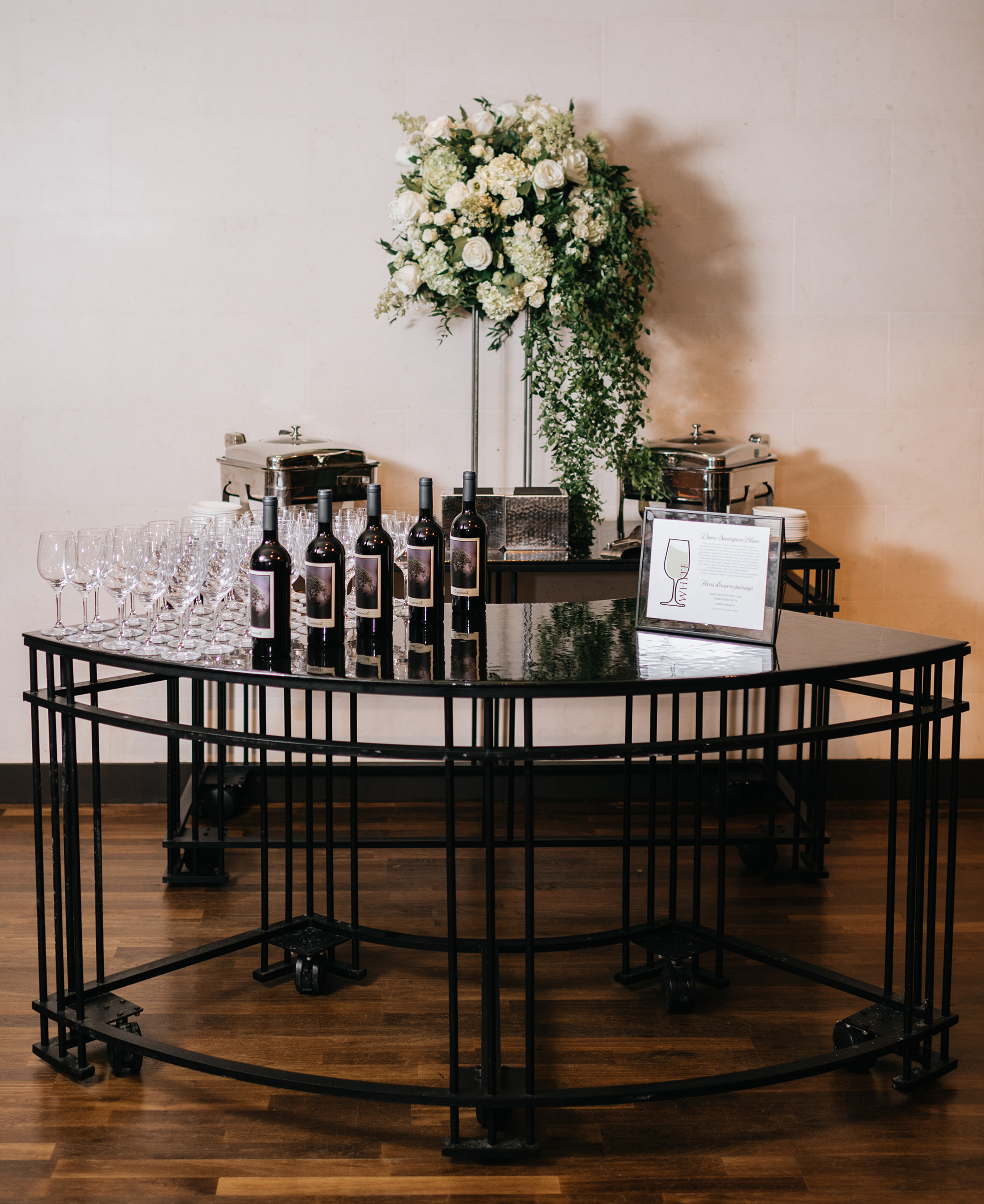 A wine tasting station at the cocktail hour of the wedding.
