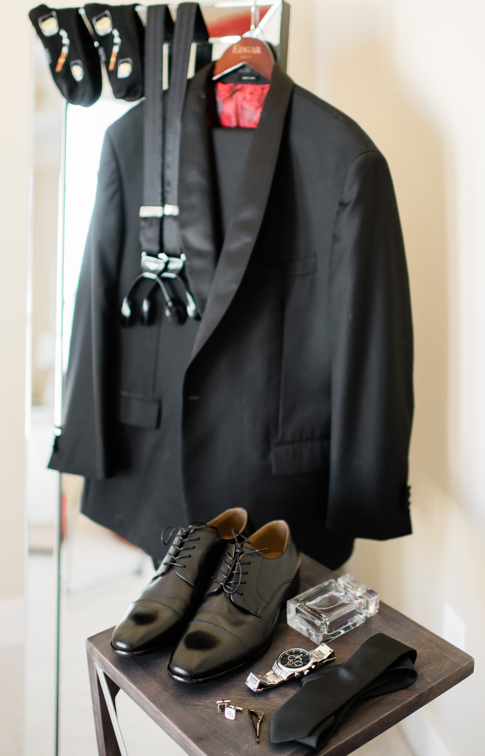 The groom's accessories and suit are set up for him to get dressed.